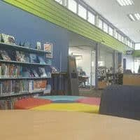 books and chairs inside Baulkham Hills Library