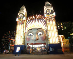photo shows a giant face at the entrance of Luna Park Sydney